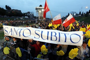 "Pilgrims hold a sign that reads, ""santo subito"" (""sainthood now""), during a vigil on the eve of the beatification of Pope John Paul II at the ancient Circus Maximus in Rome April 30. (CNS photo/Paul Haring) (April 30, 2011) See JPII-VIGIL April 30, 2011."